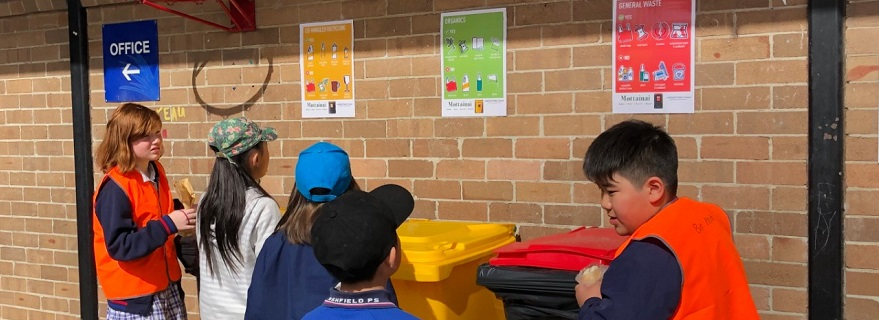 Monitors assist students to choose the correct bin for waste disposal.