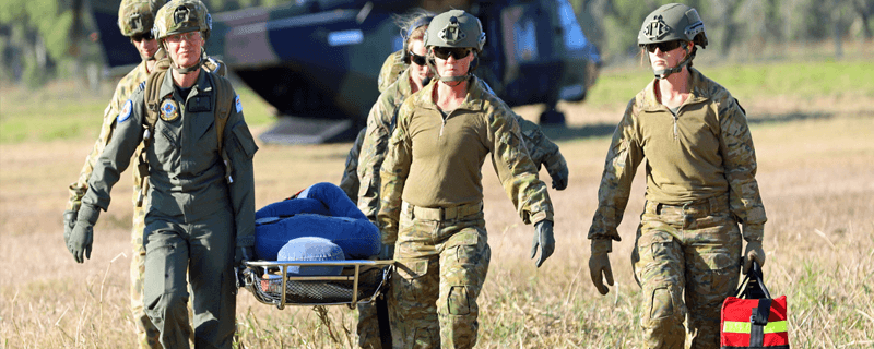 Australian Medivac army staff carrying a stretcher
