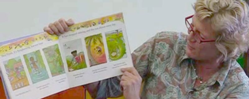 Alison Lester showing one of her picture books.